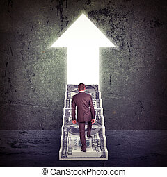 Businessman climbing up stairs