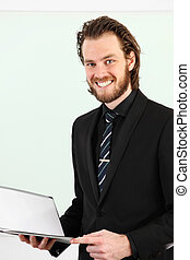 Businessman closeup with clipboard
