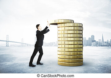 Businessman collects a stack of gold coins, saving money concept