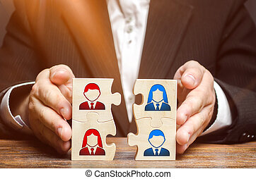 Businessman collects puzzles symbolizing the team of employees. Combining teams and people to perform work. The combination and selection of personnel for specific work. project management