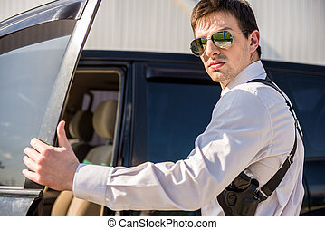 Businessman coming out of a car