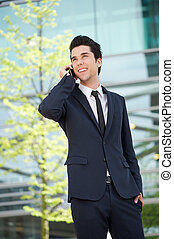 Businessman communicating on mobile phone outdoors