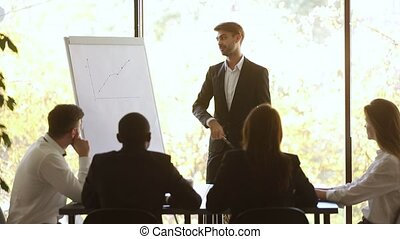 Businessman conference speaker give flip chart presentation get team applause