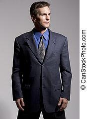 Businessman - Confident businessman grey background