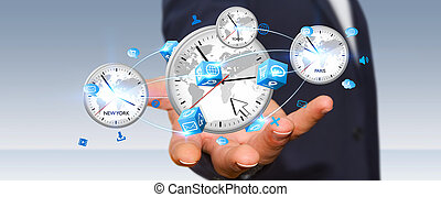 Businessman connecting time of the world in his hand