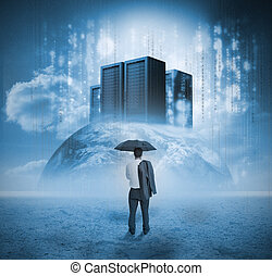 Businessman contemplating servers on earth with raining...