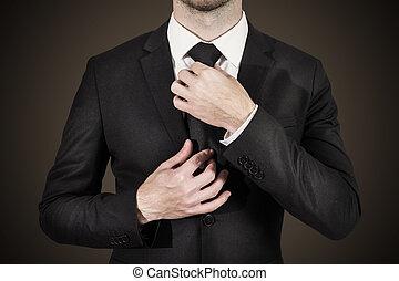 businessman correcting tie fashion - businessman in black ...