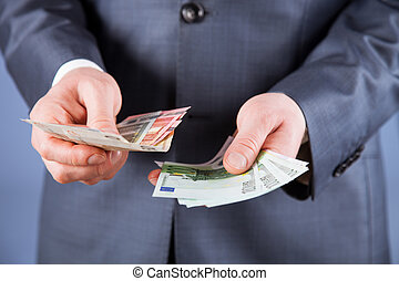 Businessman counting euro money
