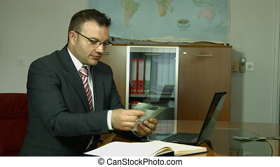 Businessman counting money.