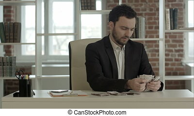 Businessman counting out some banknotes