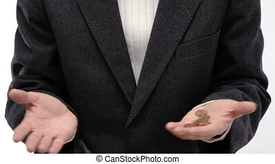 Businessman counting the coins in the palm of his hand -...