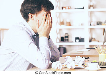 Businessman covering face - Stressed young businessman ...