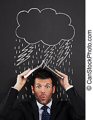 Businessman covering head from rain