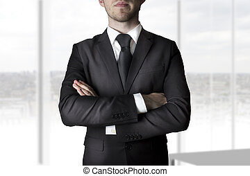 businessman crossed arms - businessman in black suit...