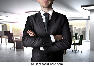 businessman crossed arms in modern office