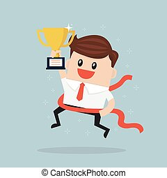 Businessman crossing finish line and holding trophy.