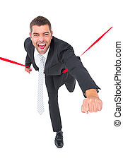 Businessman crossing the finish line on white background