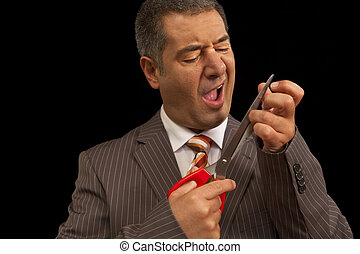 Businessman cutting nails with huge scisors, just hurt...