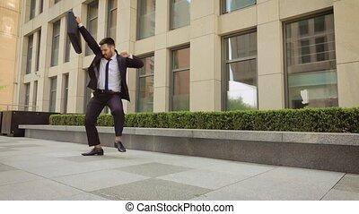 Businessman dancing Contemporary happy funky caucasian...