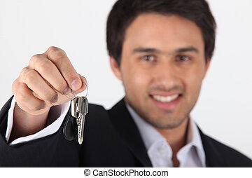 Businessman dangling keys