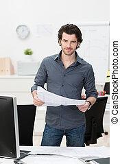 Businessman dealing with paperwork