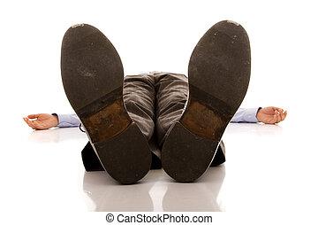 Businessman defeated - businessman feet of a dead body...