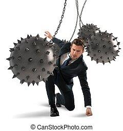 Businessman determined but hampered - Businessman between...