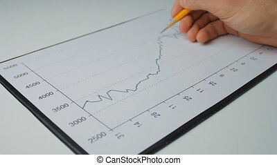 Businessman developing a business project and analyzing market data information.