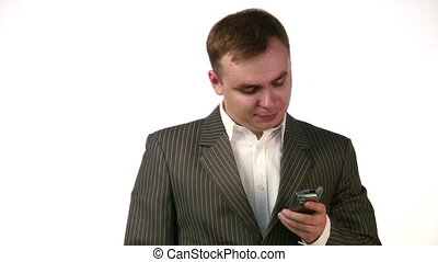 businessman dialing number on phone