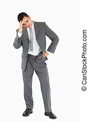 Businessman disappointed against a white background
