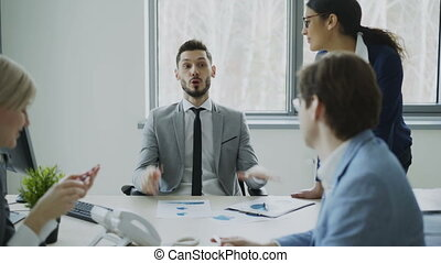 Businessman discussing future business project with male and...