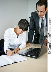 Businessman discussing something with his secretary