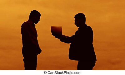 businessman discussion evil boss sunset silhouette sunlight...