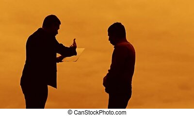 businessman discussion sunset silhouette sunlight standing...