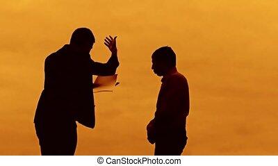 businessman discussion sunset silhouette sunlight evil boss...