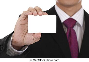 Businessman displaying a blank card