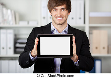 Businessman Displaying Digital Tablet In Office