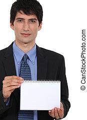 Businessman displaying notepad