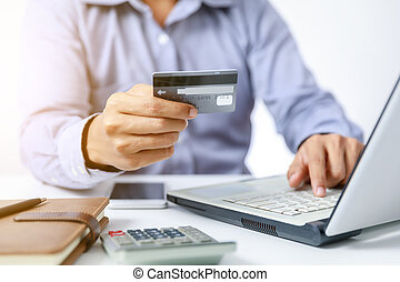 businessman do online shopping on computer with credit card