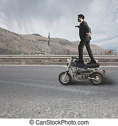 Businessman does dangerous stunts