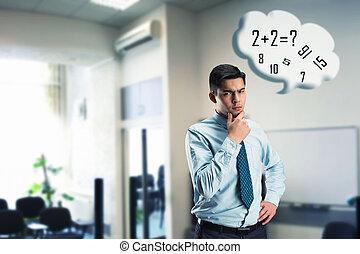 Businessman doing mental arithmetic - Young businessman...