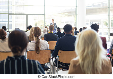 Businessman doing speech in conference room