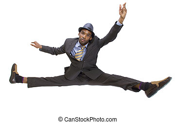 athletic black man in a suit doing the splits