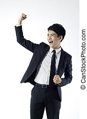 Businessman doing victory gesture