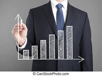 Businessman drawing a growing chart
