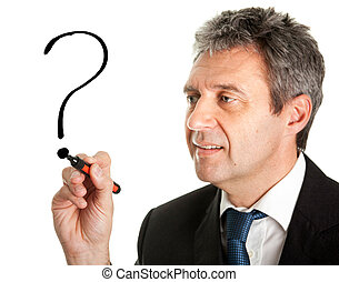 Businessman drawing a question mark