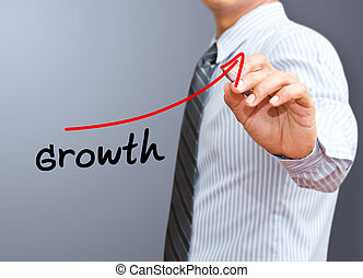 Businessman drawing a rising arrow, representing business growth