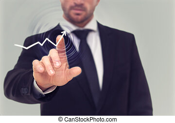Businessman drawing an arrow on the screen