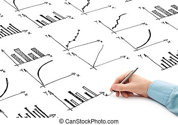 Businessman drawing bar chart and other infographics in note pad. Close up image with selective focus. Business situation.
