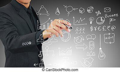 businessman drawing business icons.